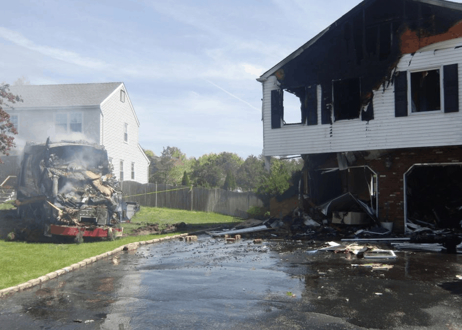 Garbage truck into a house with active fire.